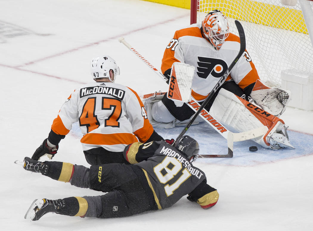 Philadelphia Flyers goaltender Brian Elliott (37) makes a second period save against Golden Knights center Jonathan Marchessault (81) with Flyers defenseman Andrew MacDonald (47) defending during ...