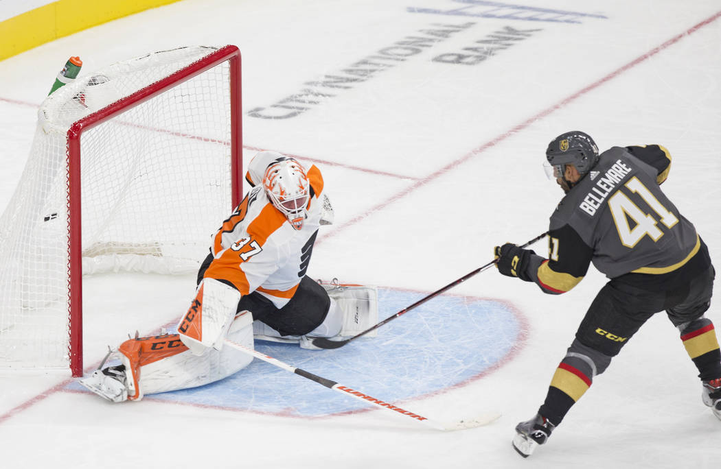 Golden Knights left wing Pierre-Edouard Bellemare (41) scores a third period goal against Philadelphia Flyers goaltender Brian Elliott (37) during their NHL hockey game on Thursday, Oct. 4, 2018, ...