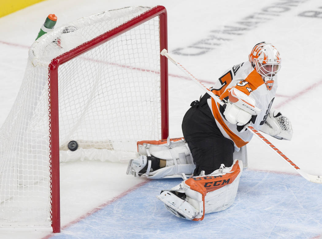 Philadelphia Flyers goaltender Brian Elliott (37) makes a third period save during their NHL hockey game with the Golden Knights on Thursday, Oct. 4, 2018, at T-Mobile Arena, in Las Vegas. Benjami ...