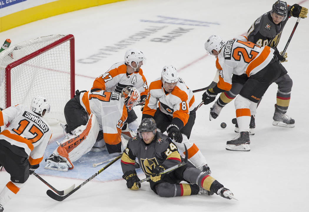 Philadelphia Flyers goaltender Brian Elliott (37) makes a third period save in traffic against Golden Knights center Oscar Lindberg (24) during their NHL hockey game on Thursday, Oct. 4, 2018, at ...