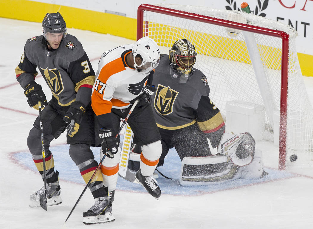 Golden Knights goaltender Malcolm Subban (30) makes a third period save against Philadelphia Flyers right wing Wayne Simmonds (17) with Golden Knights defenseman Brayden McNabb (3) defending durin ...