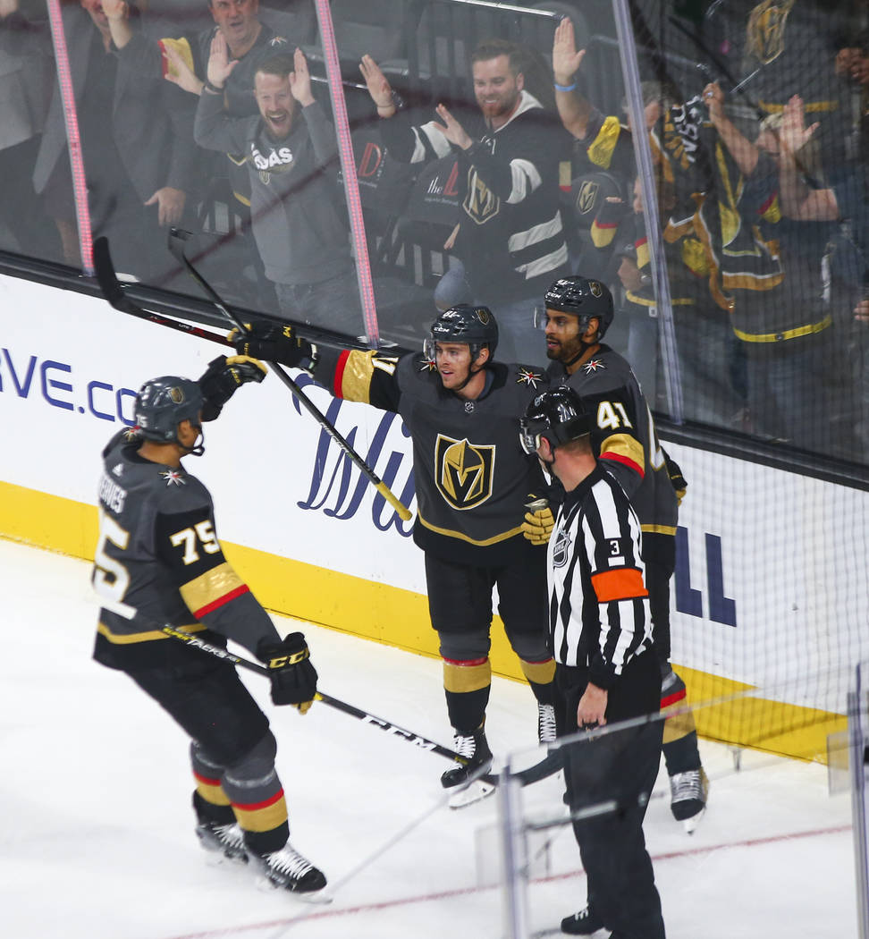 Golden Knights center Jonathan Marchessault (81) celebrates his goal with Golden Knights right wing Ryan Reaves (75) and Golden Knights left wing Pierre-Edouard Bellemare (41) during the first per ...