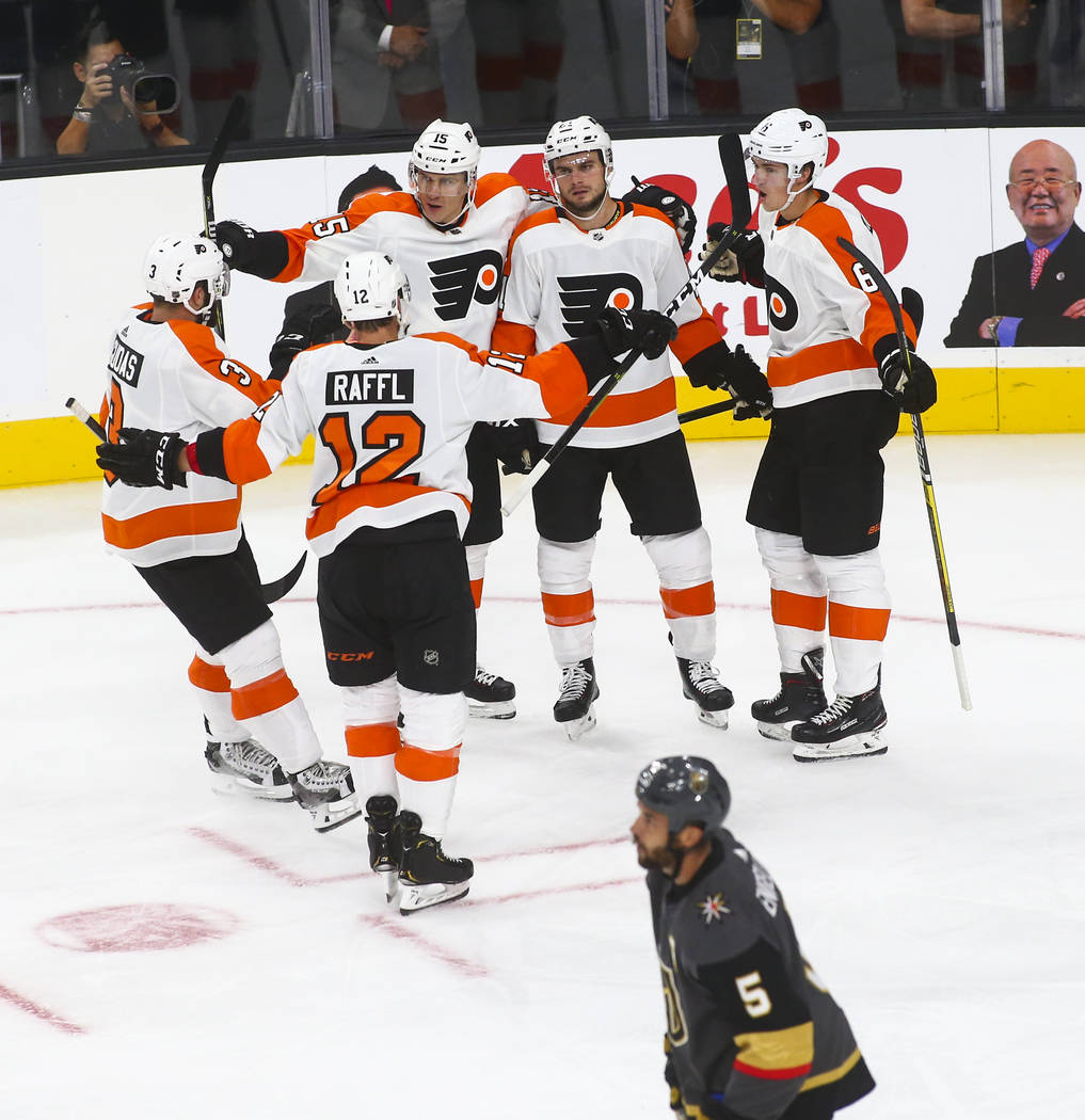 Philadelphia Flyers players celebrate their 5th goal against the Golden Knights during the second period of a season-opening game at T-Mobile Arena in Las Vegas on Thursday, Oct. 4, 2018. Chase St ...
