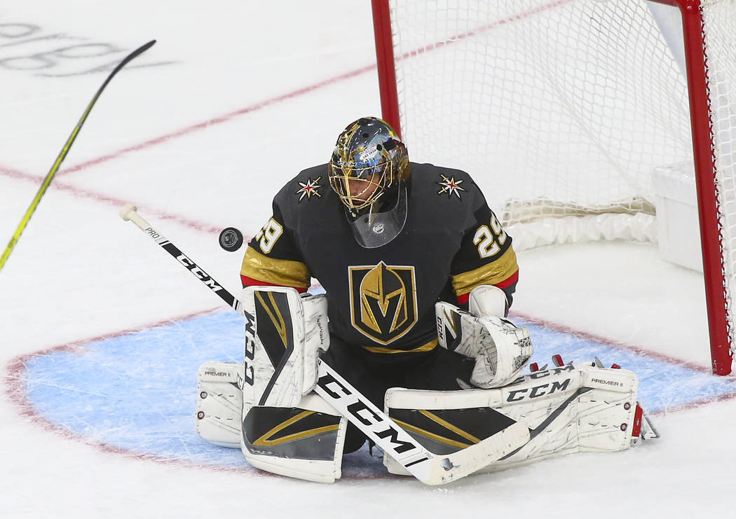 The Philadelphia Flyers get the puck past Golden Knights goaltender Marc-Andre Fleury (29) to score a 5th goal during the second period of a season-opening game at T-Mobile Arena in Las Vegas on T ...