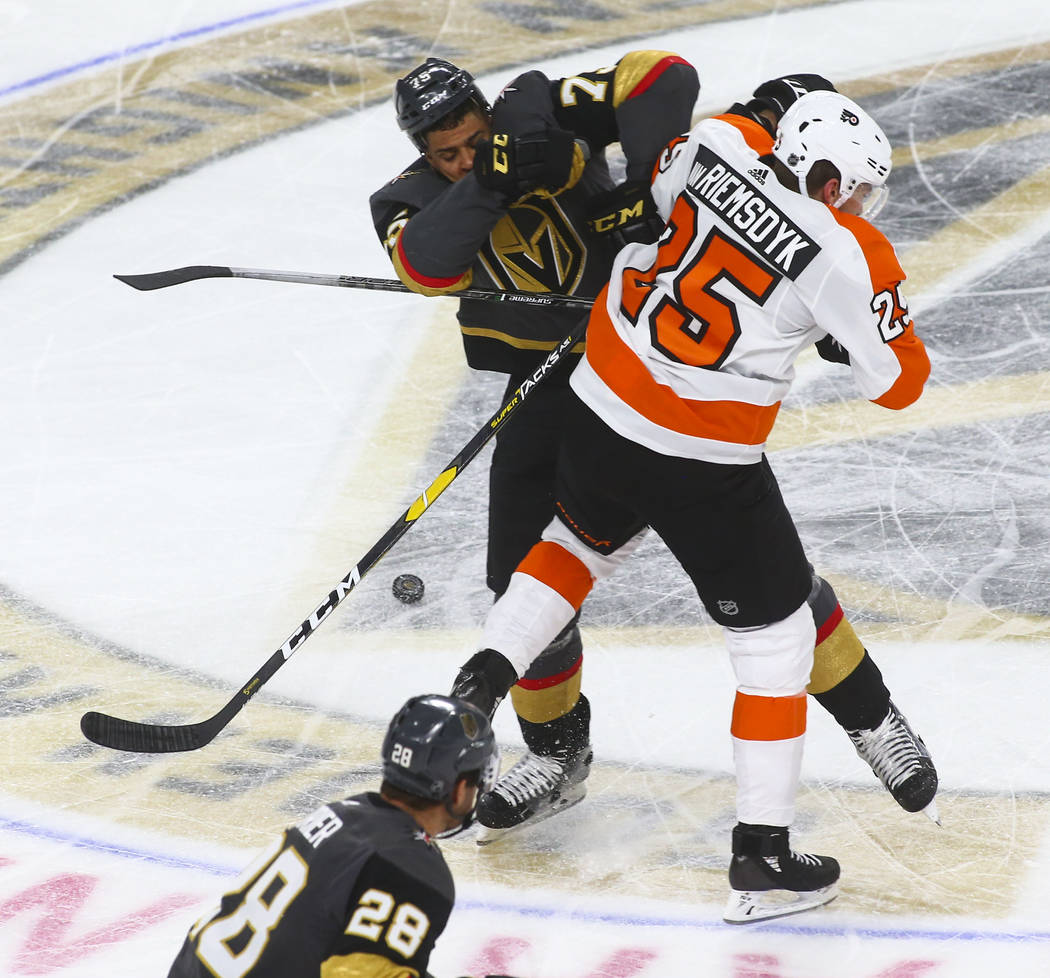 Golden Knights right wing Ryan Reaves (75) and Philadelphia Flyers left wing James van Riemsdyk (25) collide during the second period of a season-opening game at T-Mobile Arena in Las Vegas on Thu ...