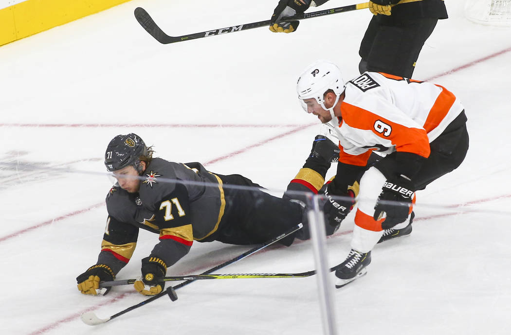 Golden Knights center William Karlsson (71) gets tripped up in front of Philadelphia Flyers defenseman Ivan Provorov (9) during the second period of a season-opening game at T-Mobile Arena in Las ...