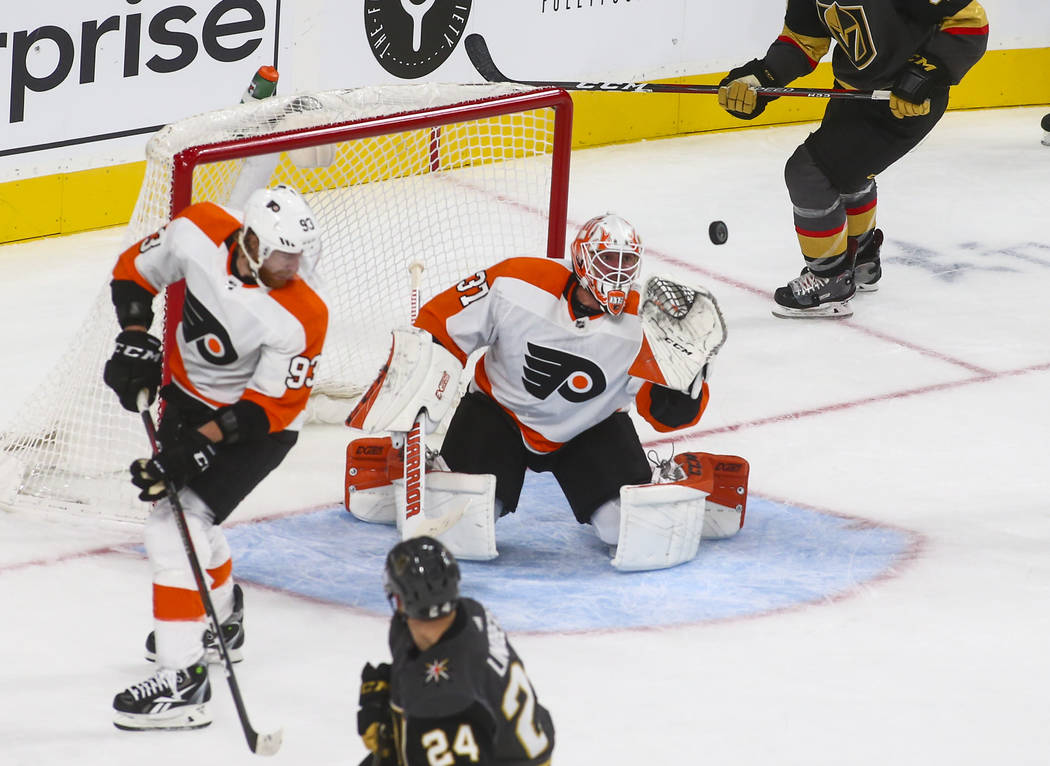 Philadelphia Flyers goaltender Brian Elliott (37) reaches out for the puck during the second period of a season-opening game against the Golden Knights at T-Mobile Arena in Las Vegas on Thursday, ...