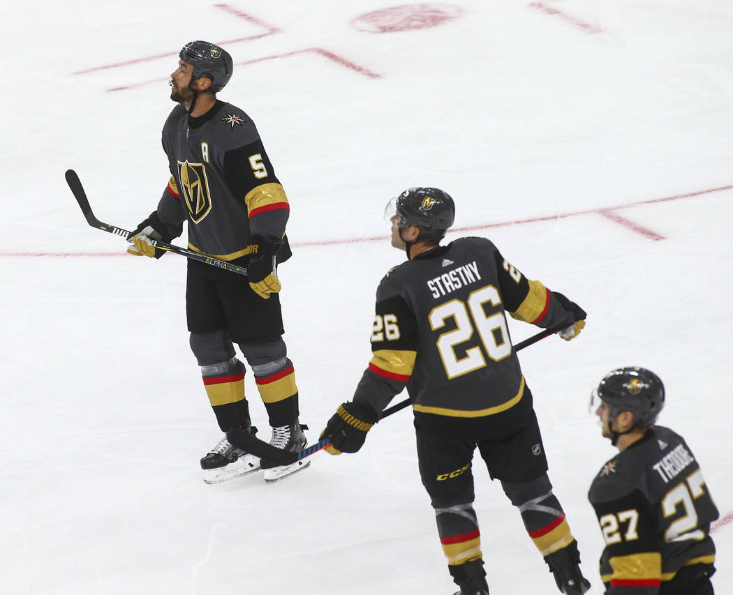 Golden Knights defenseman Deryk Engelland (5) and Golden Knights center Paul Stastny (26) react as they trail the Philadelphia Flyers 5-1 during the second period of a season-opening game at T-Mob ...