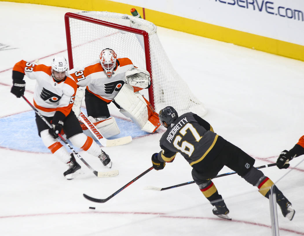 Golden Knights left wing Max Pacioretty (67) looks to shoot against Philadelphia Flyers defenseman Shayne Gostisbehere (53) and Philadelphia Flyers goaltender Brian Elliott (37) during the first p ...