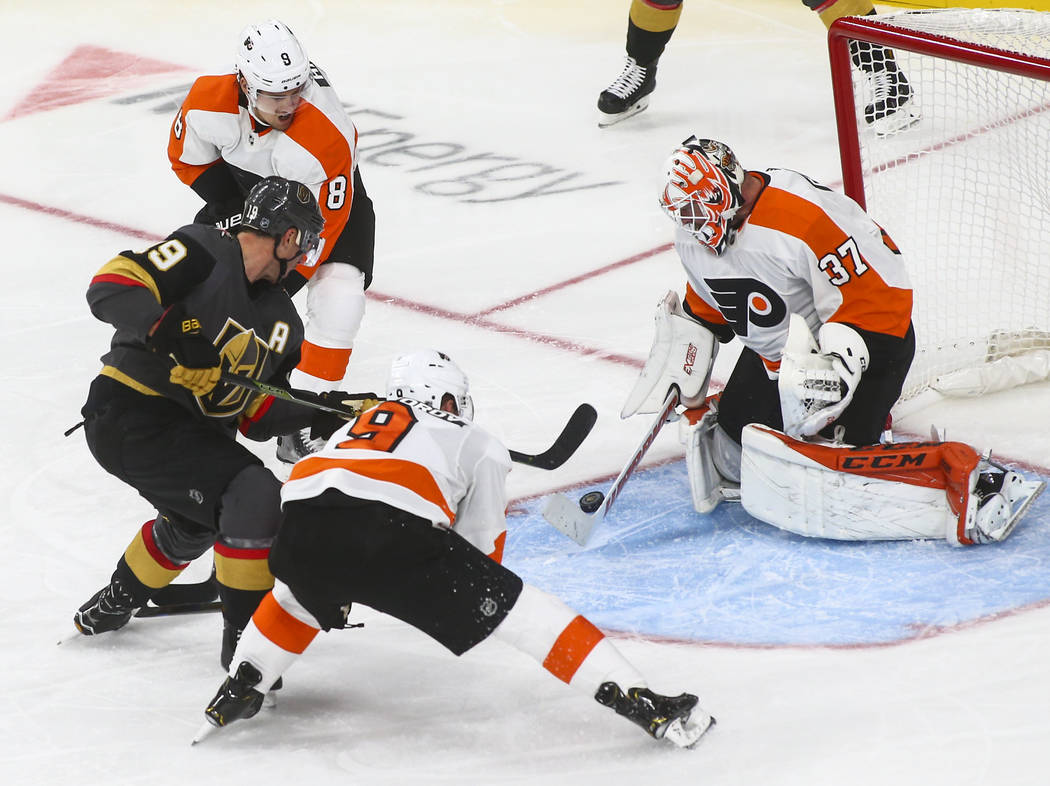 Philadelphia Flyers goaltender Brian Elliott (37) blocks a shot from Golden Knights right wing Reilly Smith (19) during the third period of a season-opening game at T-Mobile Arena in Las Vegas on ...