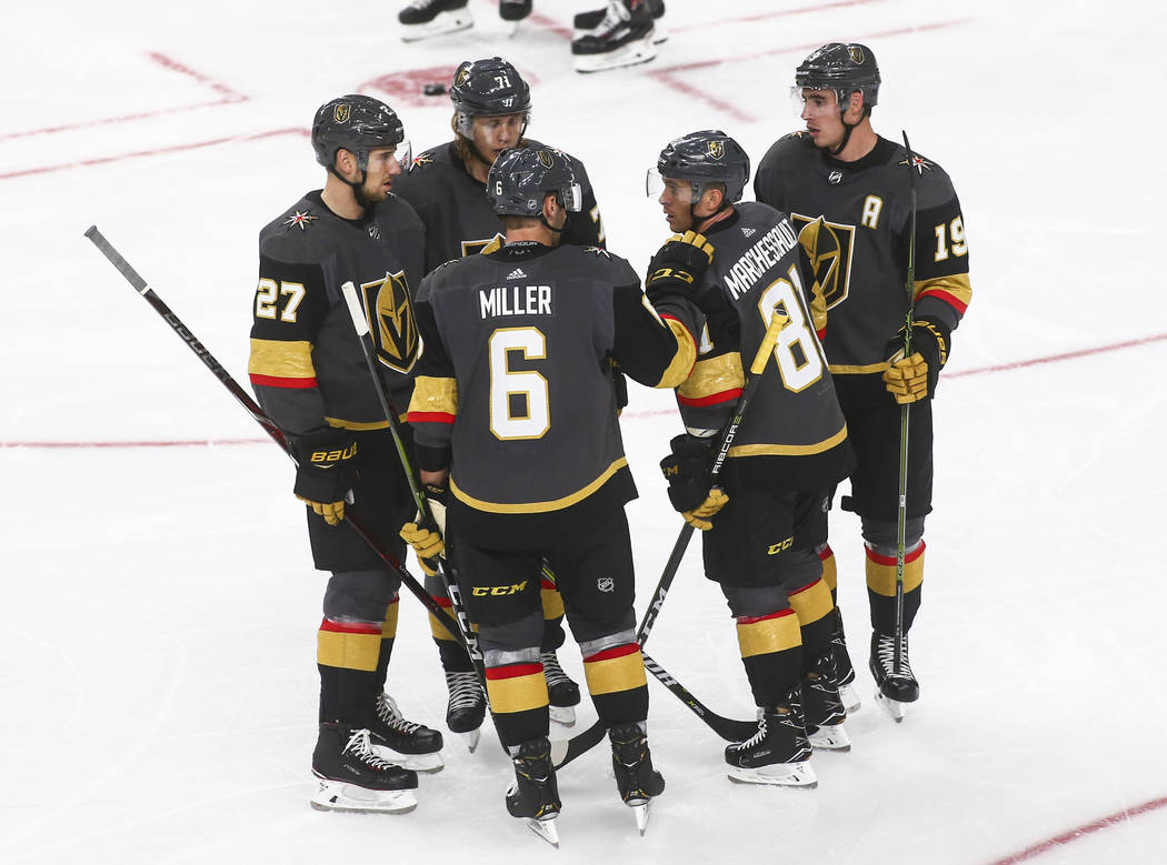Golden Knights players talk between plays against the Philadelphia Flyers during the third period of a season-opening game at T-Mobile Arena in Las Vegas on Thursday, Oct. 4, 2018. Chase Stevens L ...