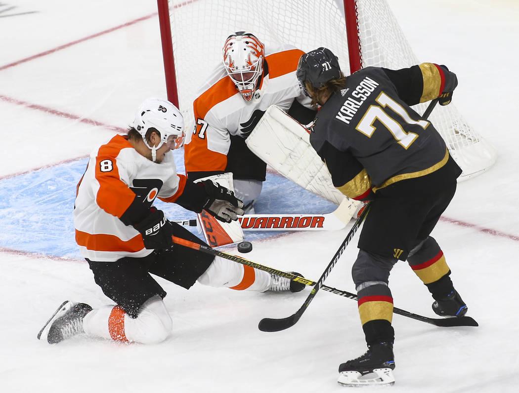 Golden Knights center William Karlsson (71) tries to score past Philadelphia Flyers defenseman Robert Hagg (8) and Philadelphia Flyers goaltender Brian Elliott (37) during the third period of a se ...