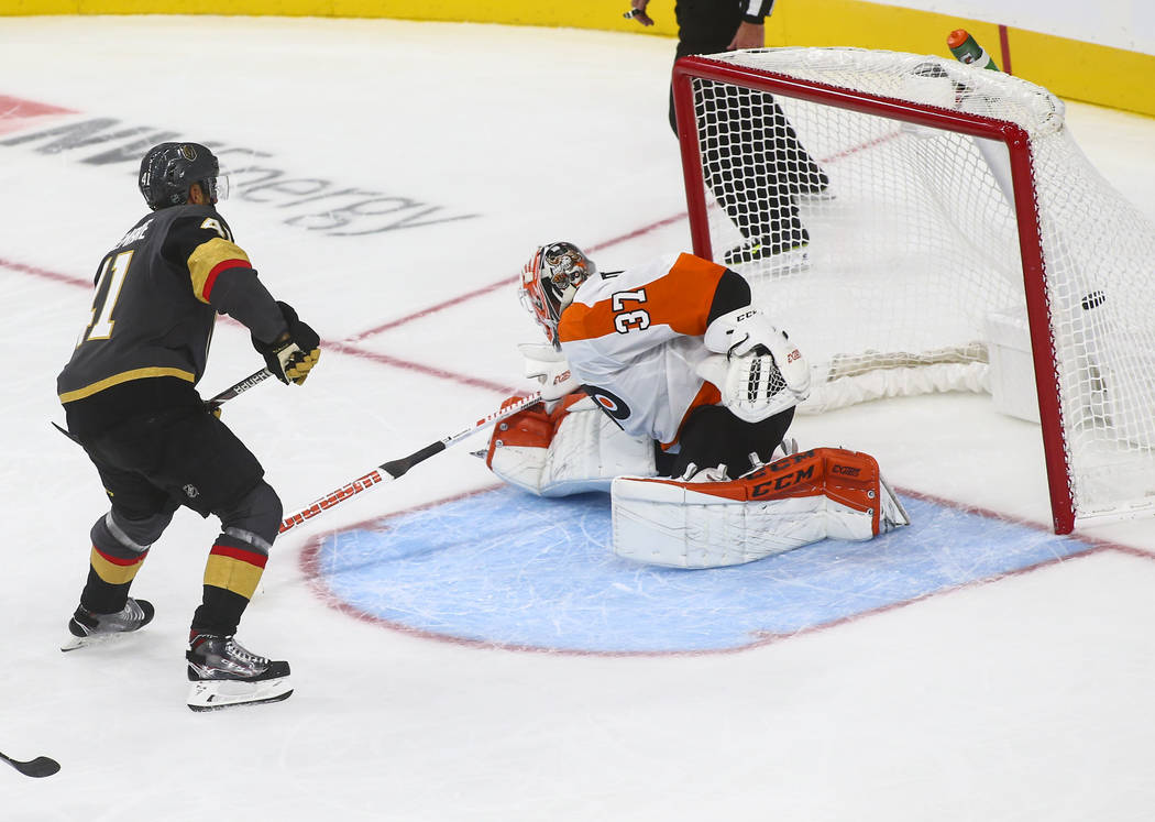 Golden Knights left wing Pierre-Edouard Bellemare (41) shoots to score past Philadelphia Flyers goaltender Brian Elliott (37) during the third period of a season-opening game at T-Mobile Arena in ...