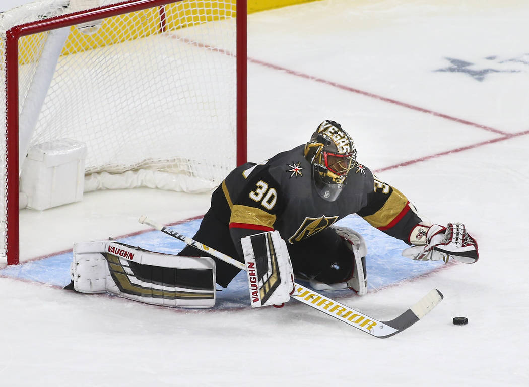 Golden Knights goaltender Malcolm Subban (30) blocks a shot from the Philadelphia Flyers during the third period of a season-opening game at T-Mobile Arena in Las Vegas on Thursday, Oct. 4, 2018. ...