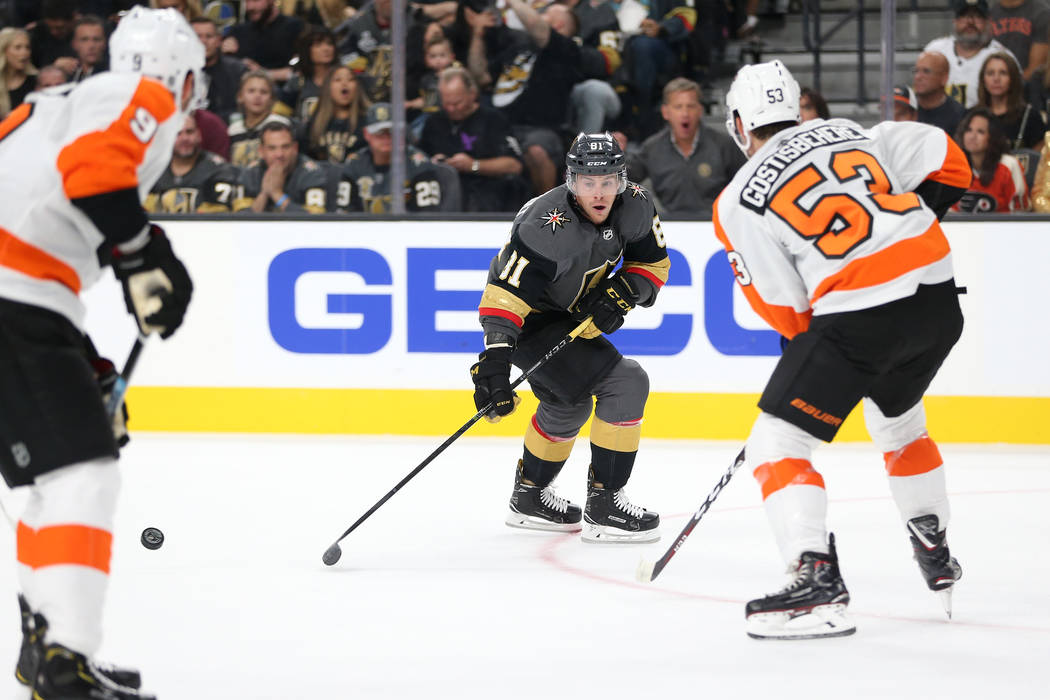Vegas Golden Knights center Jonathan Marchessault (81) loses the puck under pressure from Philadelphia Flyers defenseman Shayne Gostisbehere (53) in the first period of a hockey game at T-Mobile A ...