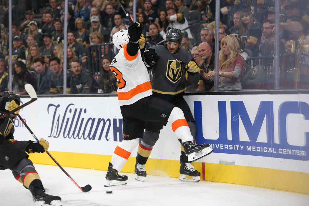Vegas Golden Knights left wing Max Pacioretty (67) takes a hit against Philadelphia Flyers defenseman Ivan Provorov (9) in the first period of the hockey game at T-Mobile Arena in Las Vegas, Thurs ...