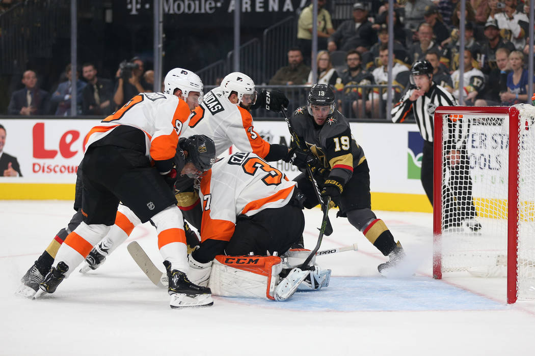 Philadelphia Flyers goaltender Brian Elliott (37) makes a stop against Vegas Golden Knights in the first period of a hockey game at T-Mobile Arena in Las Vegas, Thursday, Oct. 4, 2018. Erik Verduz ...