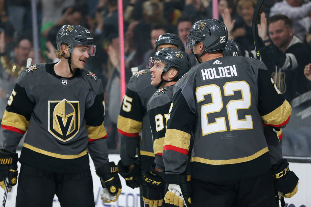 Vegas Golden Knights center Jonathan Marchessault (81), center, celebrates his score against Philadelphia Flyers in the first period of a hockey game at T-Mobile Arena in Las Vegas, Thursday, Oct. ...