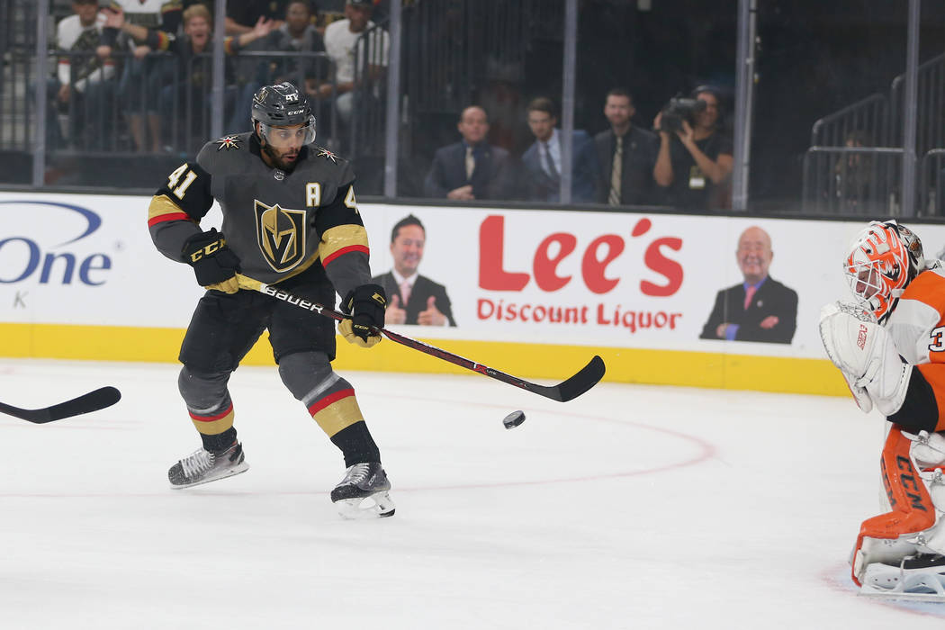 Vegas Golden Knights left wing Pierre-Edouard Bellemare (41) takes a shot against Philadelphia Flyers goaltender Brian Elliott (37) in the first period of a hockey game at T-Mobile Arena in Las Ve ...