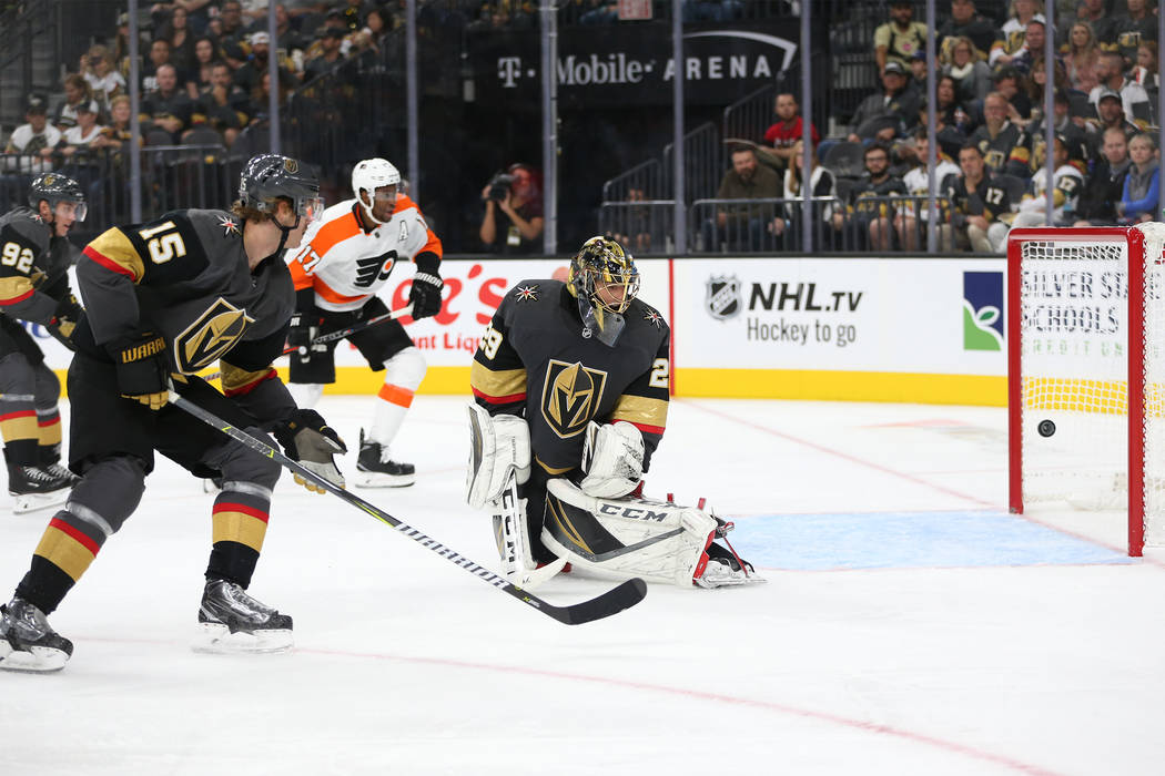 Vegas Golden Knights goaltender Marc-Andre Fleury (29) misses the puck for a score by Philadelphia Flyers in the second period of a hockey game at T-Mobile Arena in Las Vegas, Thursday, Oct. 4, 20 ...