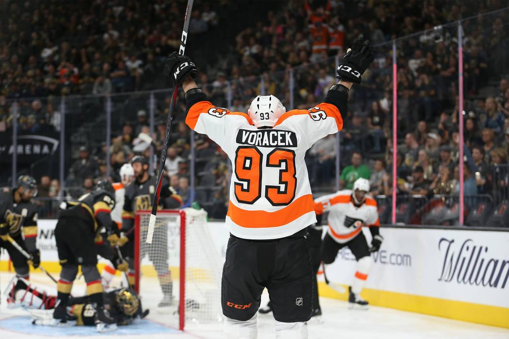 Philadelphia Flyers right wing Jakub Voracek (93) celebrates a score by right wing Wayne Simmonds (17) in the second period of a hockey game at T-Mobile Arena in Las Vegas, Thursday, Oct. 4, 2018. ...