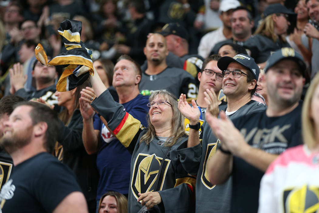 Fans celebrate a goal by Vegas Golden Knights left wing Pierre-Edouard Bellemare (41) against Philadelphia Flyers in the third period of a hockey game at T-Mobile Arena in Las Vegas, Thursday, Oct ...