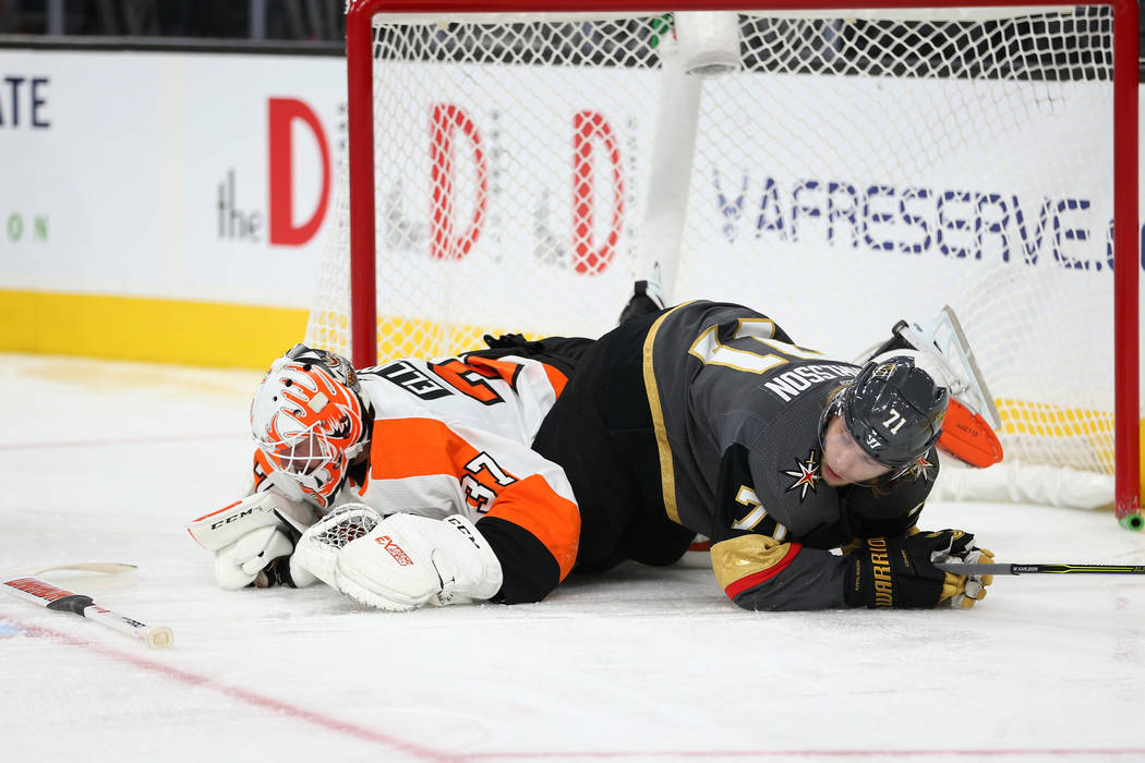 Vegas Golden Knights center William Karlsson (71) collides with Philadelphia Flyers goaltender Brian Elliott (37) in the third period of a hockey game at T-Mobile Arena in Las Vegas, Thursday, Oct ...
