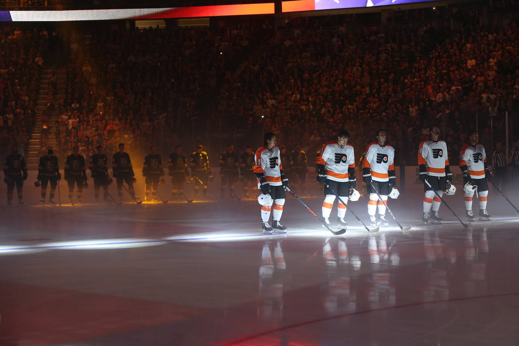 Players from the Vegas Golden Knights and Philadelphia Flyers during the national anthem at T-Mobile Arena in Las Vegas, Thursday, Oct. 4, 2018. Erik Verduzco Las Vegas Review-Journal @Erik_Verduzco