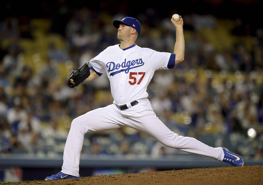 Los Angeles Dodgers pitcher Alex Wood throws to an Atlanta Braves batter during the ninth inning of Game 1 of a baseball National League Division Series on Thursday, Oct. 4, 2018, in Los Angeles. ...