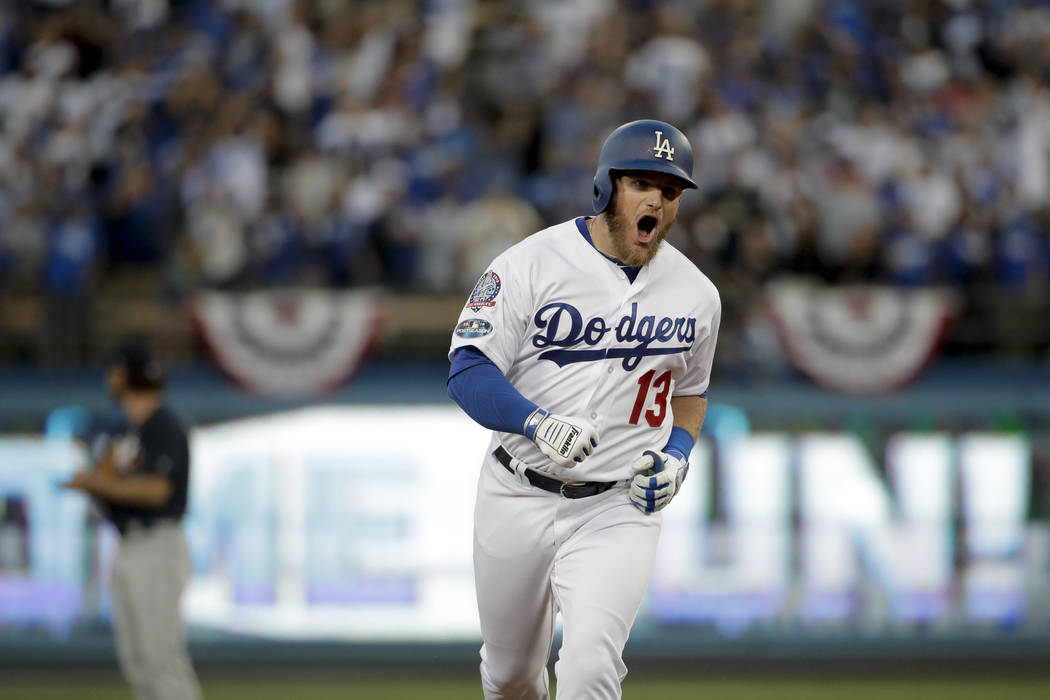 Los Angeles Dodgers' Max Muncy celebrates after hitting a three-run home run during the second inning of Game 1 of the National League Division Series against the Atlanta Braves on Thursday, Oct. ...