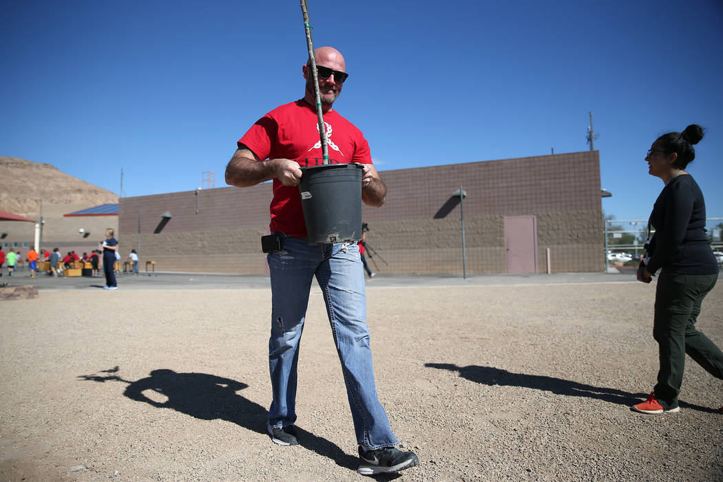 Volunteer Jack Hines helps plant a tree at Forbuss Elementary School in Las Vegas as part of United Way of Southern Nevada's third annual Day of Caring, Friday, Oct. 5, 2018. Erik Verduzco Las Veg ...