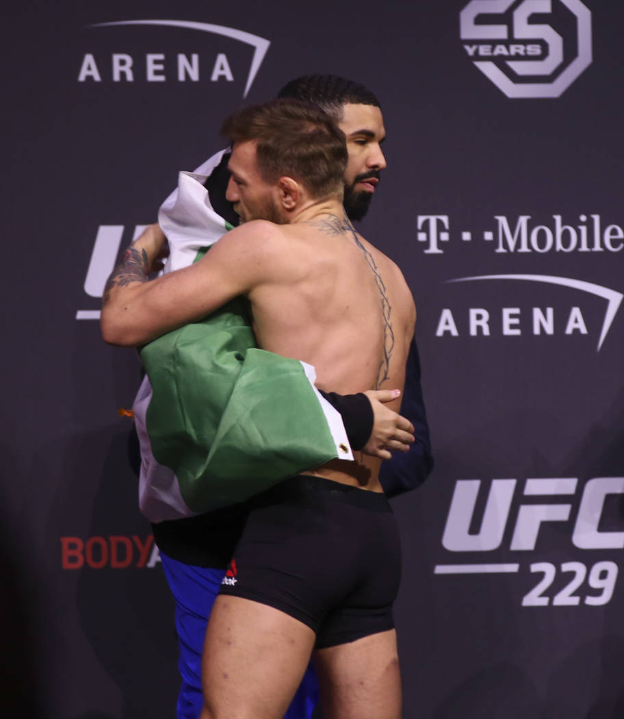 Conor McGregor hugs Drake during the ceremonial weigh-in event ahead of his fight against Khabib Nurmagomedov in UFC 229 at T-Mobile Arena in Las Vegas on Friday, Oct. 5, 2018. Chase Stevens Las V ...