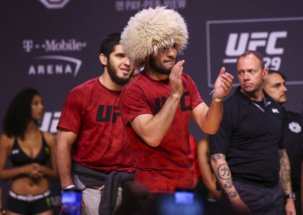Khabib Nurmagomedov claps during the ceremonial weigh-in event ahead of his fight against Conor McGregor in UFC 229 at T-Mobile Arena in Las Vegas on Friday, Oct. 5, 2018. Chase Stevens Las Vegas ...