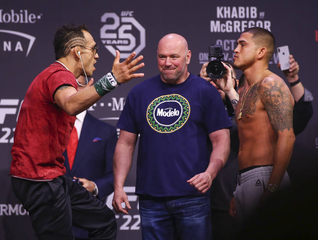 Tony Ferguson, left, and Anthony Pettis face off during the ceremonial weigh-in event ahead of UFC 229 at T-Mobile Arena in Las Vegas on Friday, Oct. 5, 2018. Chase Stevens Las Vegas Review-Journa ...