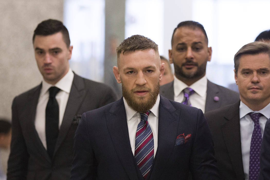 FILE - In this July 26, 2018, file photo, mixed martial arts fighters Conor McGregor leaves the courthouse following a hearing in New York. McGregor will return to mixed martial arts on Oct. 6 in ...