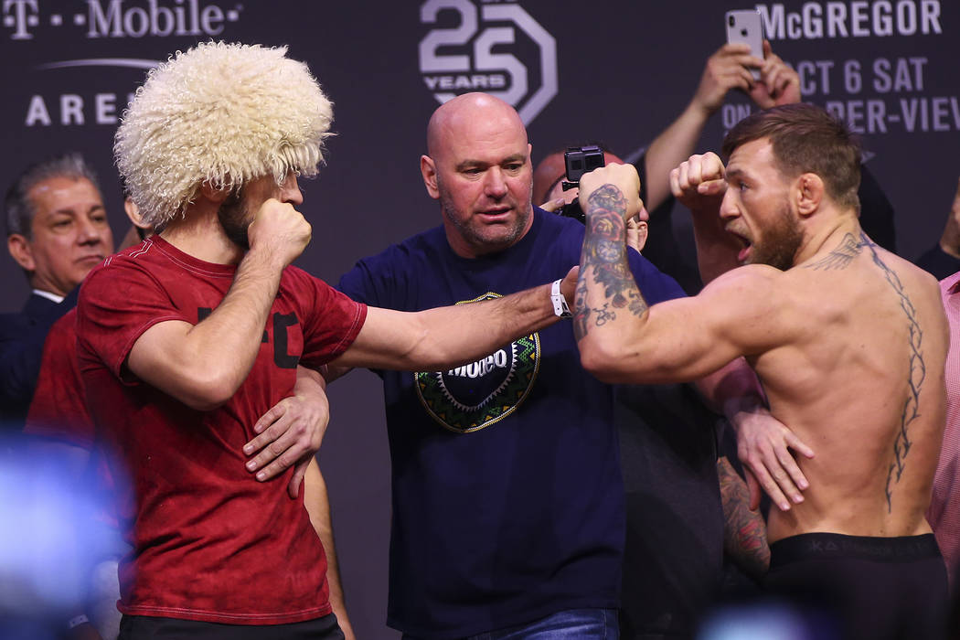 Khabib Nurmagomedov, left, faces off against Conor McGregor during the ceremonial weigh-in event ahead of UFC 229 at T-Mobile Arena in Las Vegas on Friday, Oct. 5, 2018. Chase Stevens Las Vegas Re ...