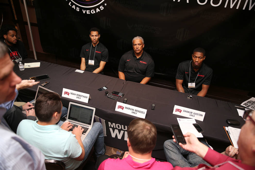 UNLV's basketball players Noah Robotham, far left, and Shakur Juiston, far right, with head coach Marvin Menzies, during the Mountain West Conference media day at the Cosmopolitan of Las Vegas hot ...