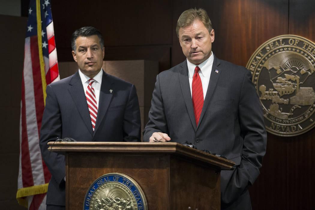 Nevada Gov. Brian Sandoval, left, and Sen. Dean Heller speak during a Las Vegas press conference in 2017. (Erik Verduzco/Las Vegas Review-Journal)