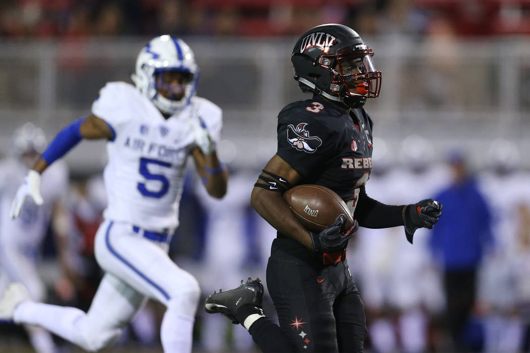 UNLV Rebels running back Lexington Thomas (3) runs the ball for a touchdown in the second quarter of the football game against Air Force Falcons at Sam Boyd Stadium in Las Vegas, Friday, Oct. 19, ...