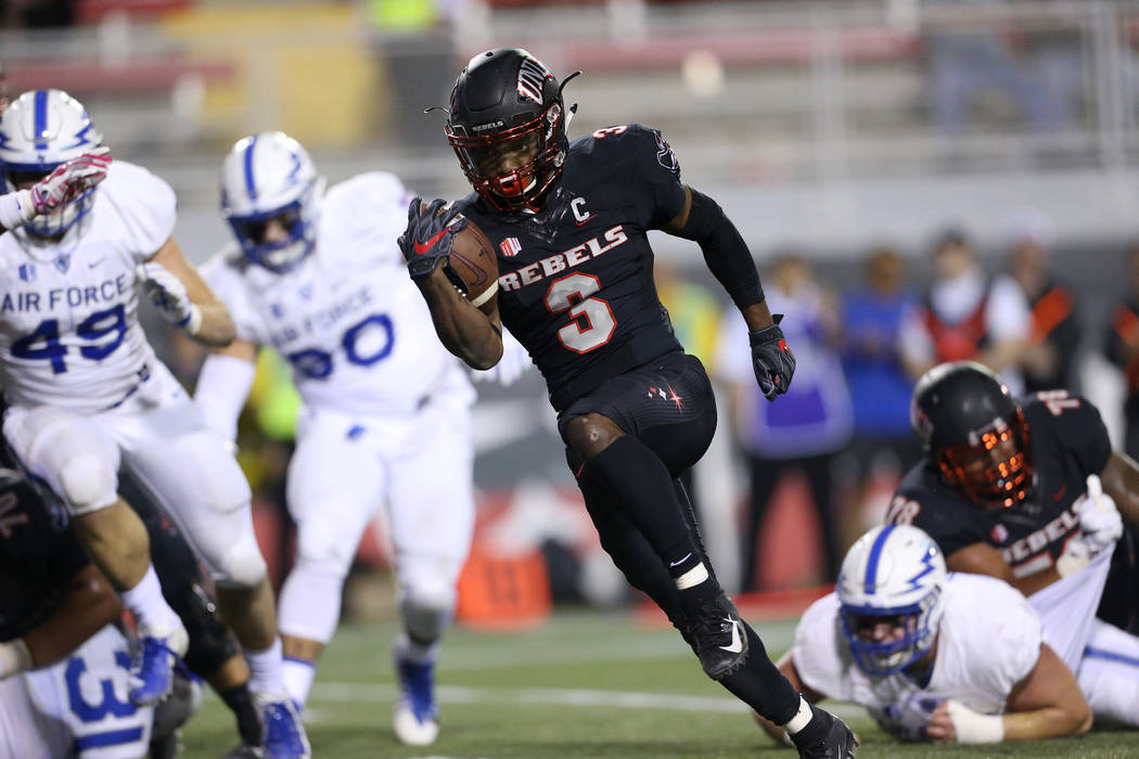UNLV Rebels running back Lexington Thomas (3) runs for a touchdown in the third quarter against Air Force Falcons in the football game at Sam Boyd Stadium in Las Vegas, Friday, Oct. 19, 2018. Erik ...