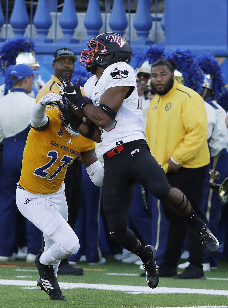 UNLV wide receiver Brandon Presley, right, catches a pass against San Jose State safety Jonathan Lenard Jr. (27) during the first half of an NCAA college football game in San Jose, Calif., Saturda ...