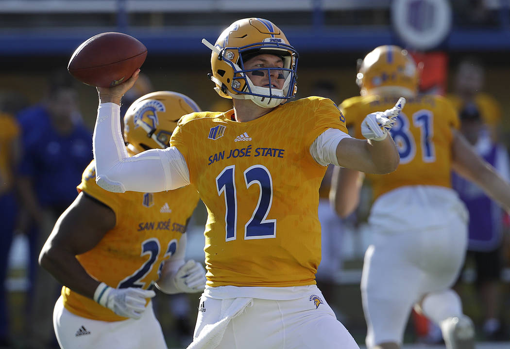 San Jose State quarterback Josh Love (12) looks to pass against UNLV during the first half of an NCAA college football game in San Jose, Calif., Saturday, Oct. 27, 2018. (AP Photo/Jeff Chiu)