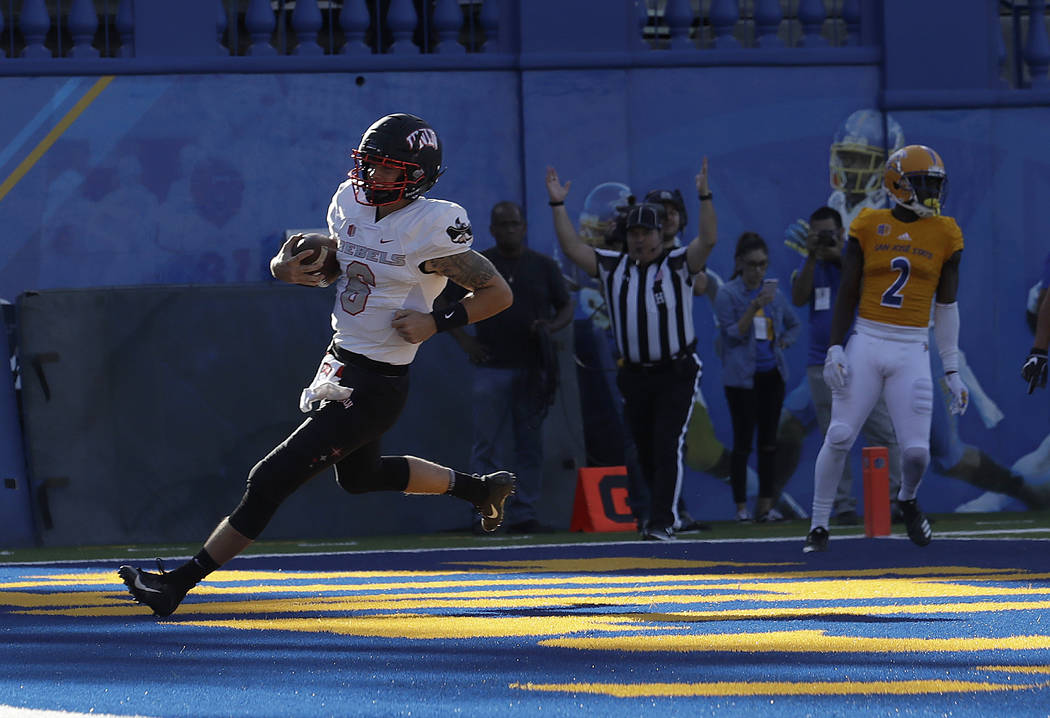 UNLV quarterback Max Gilliam (6) scores a touchdown against San Jose State during the first half of an NCAA college football game in San Jose, Calif., Saturday, Oct. 27, 2018. (AP Photo/Jeff Chiu)