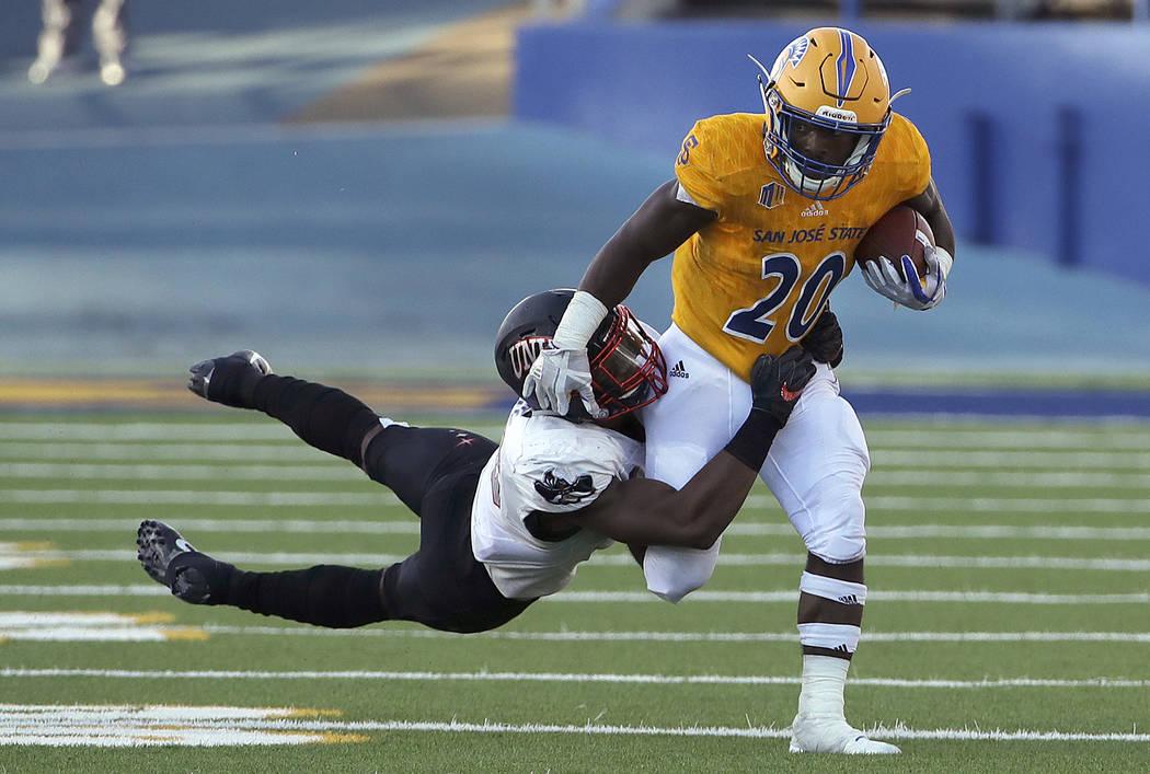 San Jose State running back Malike Roberson (20) runs agains UNLV linebacker Javin White during the first half of an NCAA college football game in San Jose, Calif., Saturday, Oct. 27, 2018. (AP Ph ...