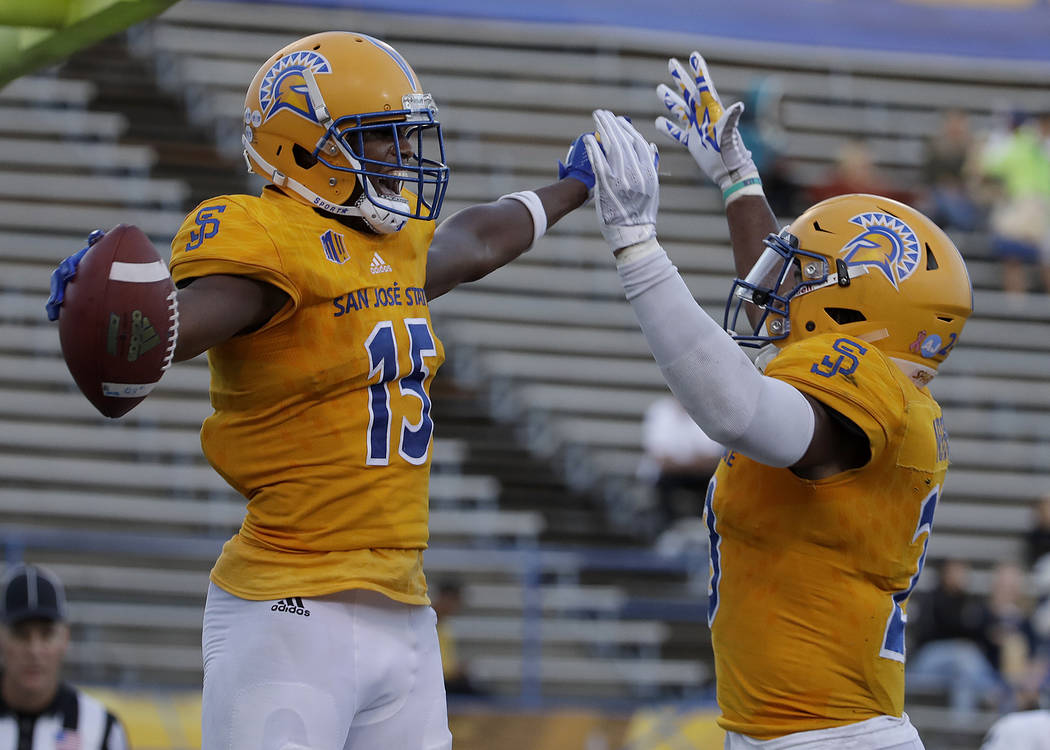 San Jose State wide receiver Tre Hartley, left, celebrates with running back Tyler Nevens after scoring a touchdown against UNLV during the second half of an NCAA college football game in San Jose ...