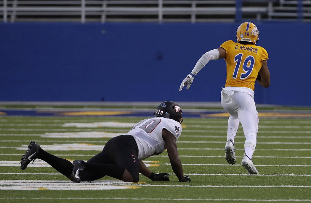 UNLV wide receiver Darren Woods Jr., left, watches as San Jose State cornerback Dakari Monroe (19) returns an interception for a touchdown during the second half of an NCAA college football game i ...
