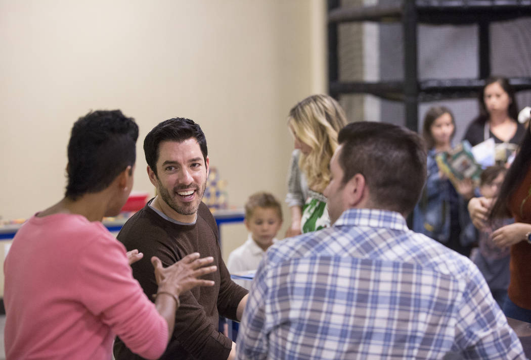 """Drew, left, and Jonathan Scott of """"Property Brothers,"""" talk with fans during a book signing at Discovery Children's Museum on Monday, Oct. 8, 2018, in Las Vegas. Benjamin Hager Las Vegas ..."""