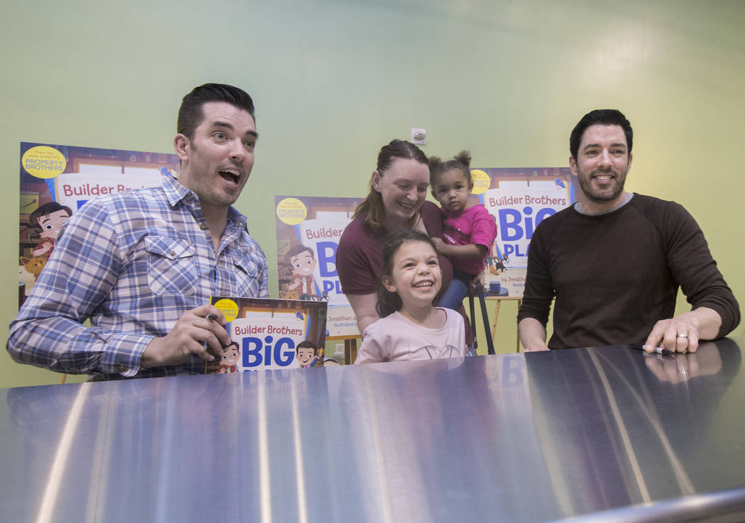 """Jonathan, left, and Drew Scott of """"Property Brothers"""" take a photo with Aubrey Bousley and her daughters Sabrina, standing, and Katie during a book signing at Discovery Children's Museum ..."""