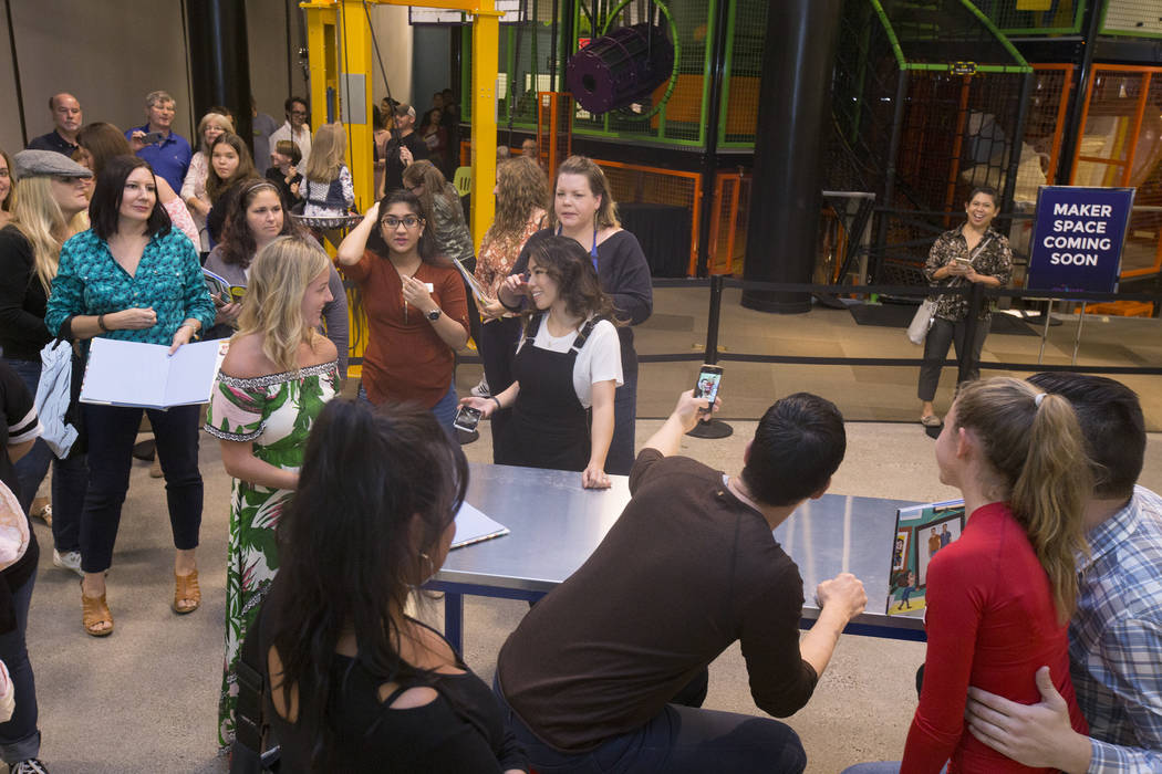 """Jonathan, right, and Drew Scott of """"Property Brothers"""" take a selfie with fans during a book signing at Discovery Children's Museum on Monday, Oct. 8, 2018, in Las Vegas. Benjamin Hager ..."""