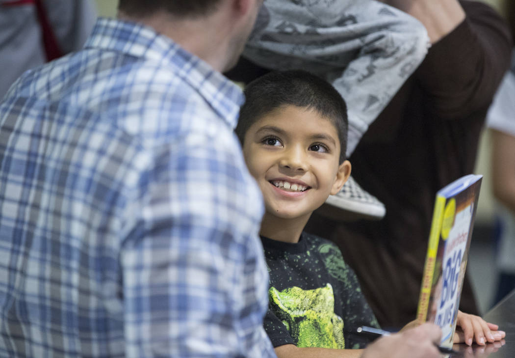 """Julian Carrera, 6, smiles at Jonathan Scott of """"Property Brothers"""" during a book signing at Discovery Children's Museum on Monday, Oct. 8, 2018, in Las Vegas. Benjamin Hager Las Vegas Re ..."""